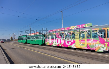 Basel, Switzerland - 31 October, 2014: a tram passing the Dreirosenbrucke bridge. Basel is Switzerland's third most populous city, located where the Swiss, French and German borders meet.