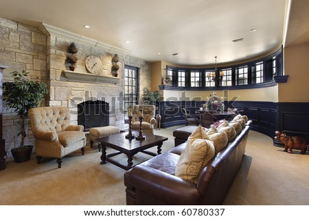 Basement in luxury home with stone fireplace - stock photo
