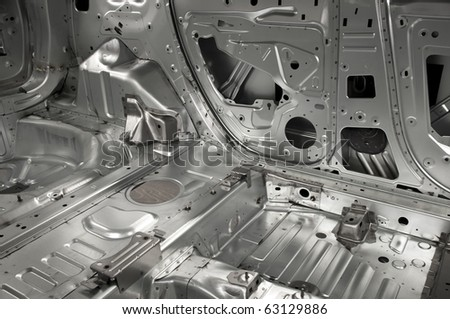 Basic interior skeleton of a car with different metal parts - stock photo