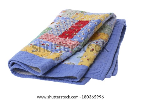Basic quilted blanked on white background - stock photo