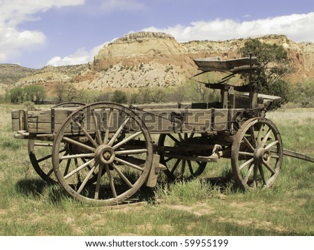Basic transportation in the Old West: wooden wagon on grassy valley floor in New Mexico - stock photo