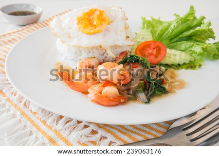 Basil fried rice with shrimp and fried egg (Pad kra prao kung), Thai food - stock photo