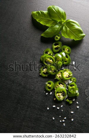 basil leaves with green hot peppers & salt - stock photo