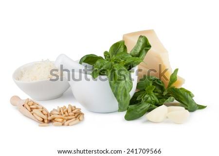 Basil pesto sauce and fresh ingredient on a white background - stock photo