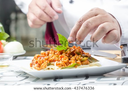 basil tomato sauce spaghetti with chicken  in white plate