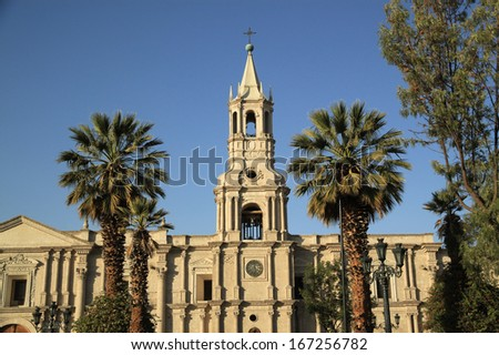Basilica Cathedral of Arequipa in Plaza de Armas, Peru, South America. The cathedral is considered one of Peru's most unusual and famous colonial cathedrals since the Spanish conquest. - stock photo
