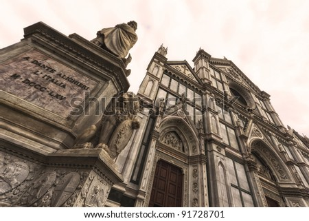 Basilica di Santa Croce (Basilica of the Holy Cross), principal Franciscan church in Florence, Italy. Gothic facade. Dante statue on the left.