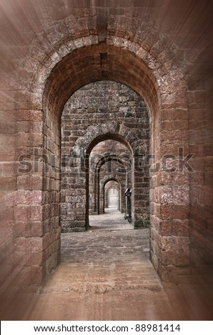 Basilica of Bom Jesus Church empty corridor with brick walls and arches in Panaji, Old Goa, India - stock photo