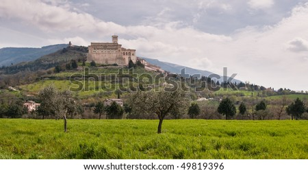 Basilica of St.Francis in Umbrian landscape - stock photo