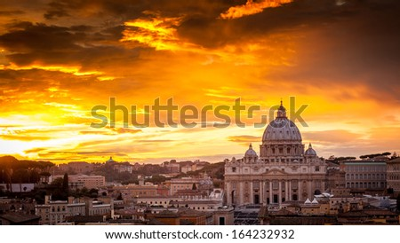 Basilica of St. Peter at sunset with the Vatican in the background in Rome, Italy - stock photo