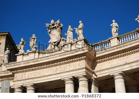 Basilica of St Peter - Rome, Italy - detail of Bernini's colonnade with statues on top and blu sky - stock photo