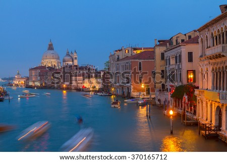 Basilica Santa Maria della Salute and Grand canal embankment at night, Venice, Italy - stock photo