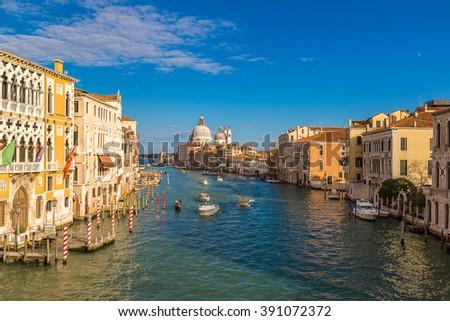 Basilica Santa Maria della Salute and Grand Canal in Venice in a beautiful summer day in Italy - stock photo