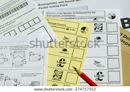 BASINGSTOKE, UK - MAY 3, 2015:  Ballot forms for postal voting in the local and general election for May 2015. - stock photo