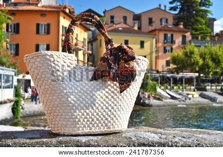 Basket against varenna town, lake Como, Italy - stock photo