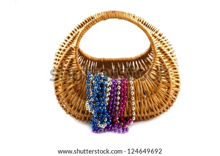 basket, and inside beads on a white background - stock photo