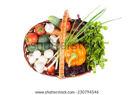 Basket cart full of fresh vegetables isolated on white, top view - stock photo