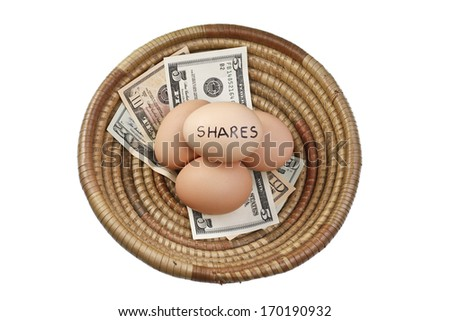 Basket Egg Investing in Shares and Money - stock photo