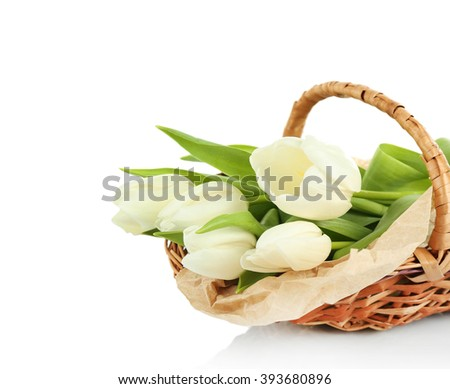 Basket filled with white tulips isolated on white - stock photo