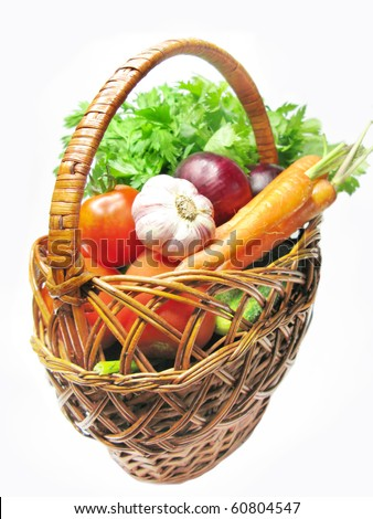 basket full of carrot cucumbers tomatoes celery red onion and garlic - stock photo
