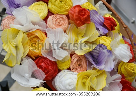 Basket full of colorful paper flowers. Wedding flower basket.Decoration bouquets of dried flowers.DRIED FLORAL BOUQUET IN A BASKET. Happy Vishu, Onam, Birthday, Wishes  - stock photo