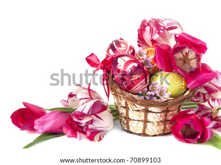 Basket full of Easter eggs and flower tulips - stock photo