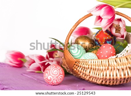 Basket full of Easter eggs  and tilips - stock photo