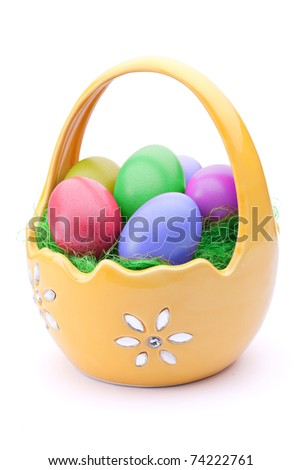 Basket full of Easter eggs isolated on white - stock photo