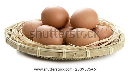 Basket full of eggs - stock photo