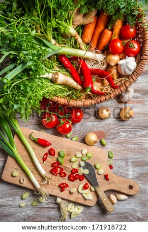 Basket full of fresh vegetables - stock photo