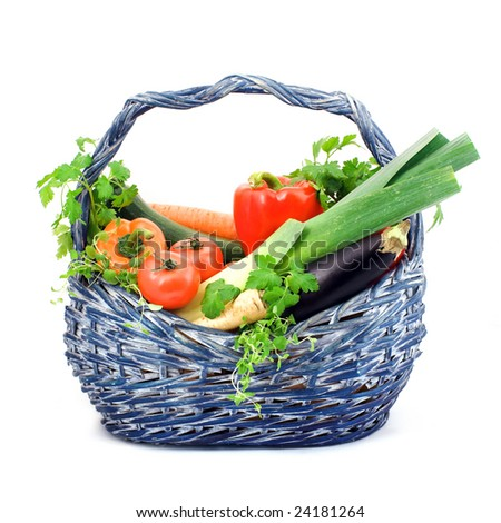 Basket full of  fresh vegetables and herbs, clipping path - stock photo
