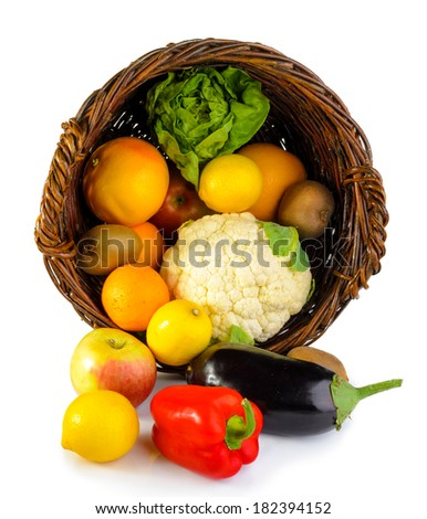 Basket full of fruits and vegetables isolated on white. - stock photo