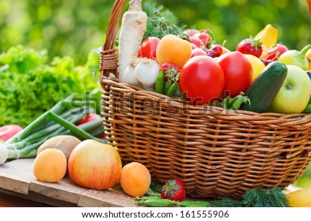 Basket full of fruits and vegetables on the table