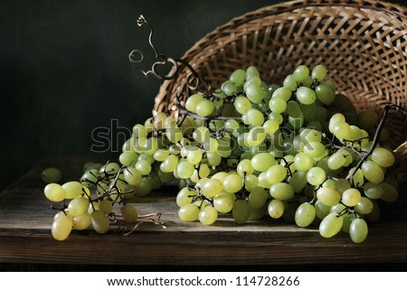 Basket full of grapes - stock photo