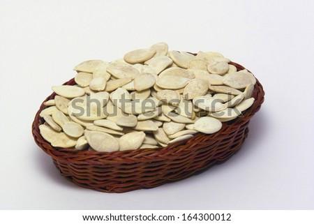 basket full of salted pumpkin seeds - stock photo