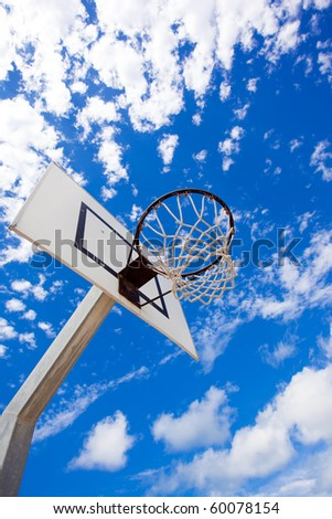 Basket hoop over a blue vivid sky - stock photo