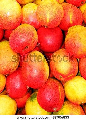 Basket mangos bunched together in a fruit market. - stock photo