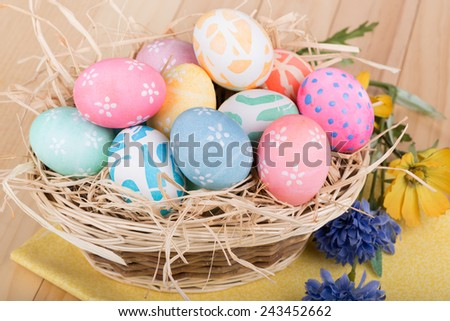 Basket of a bunch of decorated Easter eggs - stock photo