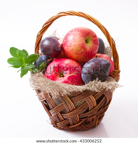 basket of apples and plums - stock photo