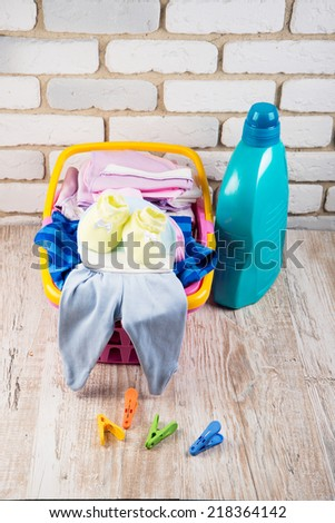 basket of baby clothes - stock photo