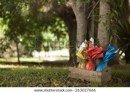 Basket of brazilian Easters eggs under a tree.