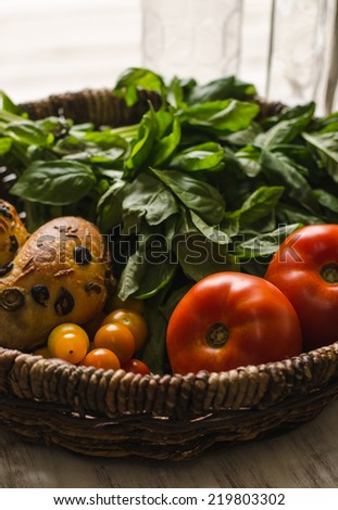 Basket of bread and produce from farmer�s market - stock photo