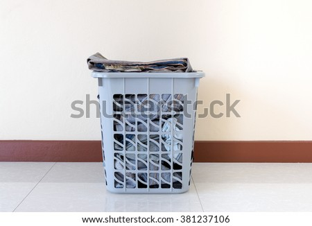 Basket of clothes to wash and prepare isolated on white background. - stock photo