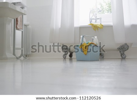 Basket of dirty clothes in bathroom - stock photo
