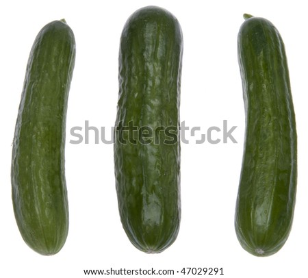 Basket of fresh cucumbers isolated on white with a clipping path.