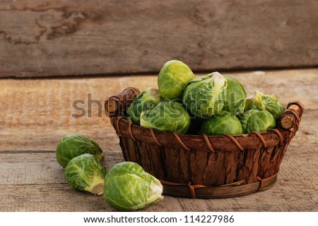 Basket of fresh green brussels sprouts - stock photo