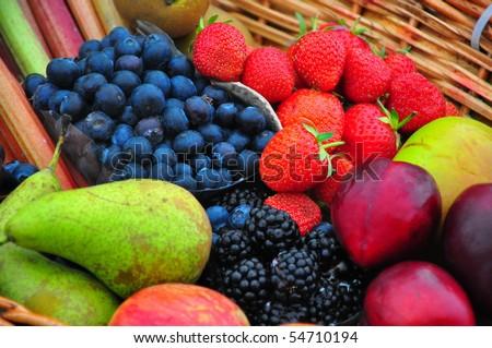 Basket of fresh summer fruit - stock photo