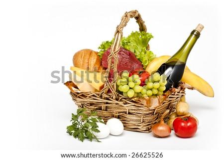 basket of goods on white background - stock photo