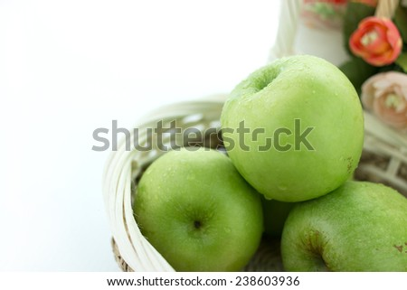basket of green apples on white background - stock photo