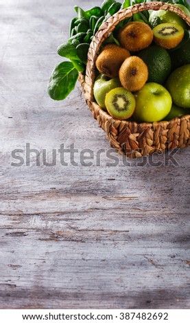 Basket of green fruit and vegetables. Healthy lifestyle.Copy space.selective focus. - stock photo